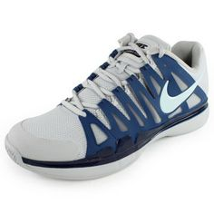 Featuring new Adaptive Fit technology and a running inspired design, the Nike Men`s Zoom Vapor 9 Tour Tennis Shoes Gray and Blue are equipped with the latest technologies designed to deliver speed and stability. Worn by Roger Federer, the Zoom Vapor 9 Tour provides optimal lightweight performance.Upper: Adaptive Fit technology provides optimized stability and fit, combined with mesh for ventilation. Running inspired design.Midsole: Full-length Phylon midsole features Nike Zoom unit in heel…