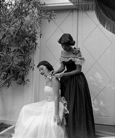 Two college students getting ready to head to a formal dance in beautiful 1940s gowns. #vintage #1940s #1948 #fashion #dress