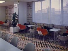 Vintage Herman Miller Chairs in 60s Japanese interior, looks like a company lunch room.