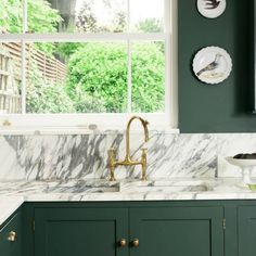 Bespoke English country kitchen by deVOL with a custom green paint color on cabinets and walls. #kitchendesign #englishkitchen #greenkitchen #deVOL