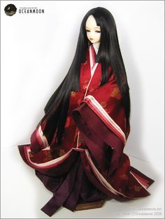 A ball jointed doll dressed in junihitoe layer by layer.