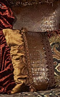 Carson Luxury Bedding is designed from an earthy woven print in charcoal, russet, and bronze tones with crushed russet velvet, croc faux leather, large tassels, beading, metal embellishments and a beautiful gold medallion covered in Swarovski crystals. This set is stunning! Our over sized bedding is designed to fit the larger beds of today with ample drop on both the duvet and the dust skirt.