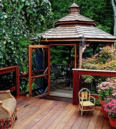 Enhance your deck with a gazebo of dark, rich Brazilian ipe wood; use planks of a lighter wood for flooring. The screened room provides a convenient location for bug-free outdoor dining.(Better Homes and Gardens)! Love a screened in gazebo! Gazebo Pergola, Screened Gazebo, Gazebo Plans, Garden Gazebo, Gazebo Ideas, Greenhouse Plans, Garden Paths, Outdoor Rooms, Outdoor Dining