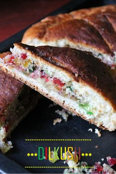 Dilkush / Dilkhush...A sweet coconut and tutti fruity stuffed sweet bread, baked to perfection..I know this is many of your favorite dish