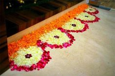 Big list Flower Rangoli Designs ideas and pictures for this ganesh chaturthi or any other Indian festivals. Learn flower rangoli designs for competition with flowers. Rangoli Designs Simple Diwali, Rangoli Simple, Rangoli Designs Flower, Rangoli Border Designs, Small Rangoli Design, Rangoli Patterns, Colorful Rangoli Designs, Rangoli Ideas, Diwali Rangoli