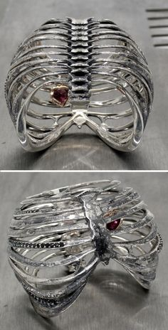Ribcage Ring by Juxtapoz Jewels...Even has jewel heart. Never seen anything like this. I dig it.