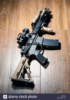 The Black Rifle: Custom build SBR on wooden floor Stock Photo: 163443923 - Alamy Shotguns, Airsoft Guns, Weapons Guns, Guns And Ammo, Cool Nerf Guns, Gun Vault, Ar Rifle, Steampunk Weapons, Ar 15 Builds