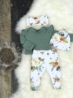 "Perfect Newborn Girl Coming Home Outfit! This outfit is crafted from quality, cozy knit, so cozy for sweet little babies! The joggers feature Earth Tome Watercolor Floral blooms, and a""yoga"" style waistband, no elastic around newborn tummy! A coordinating ruffle sleeve top in"