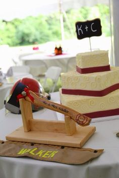 Personalized firefighter wedding cake axe. https://www.etsy.com/shop/GiveEmTheAxe