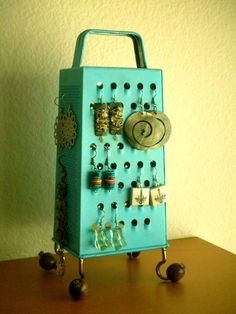 Spray painted cheese grater as earring holder. Nice idea!!