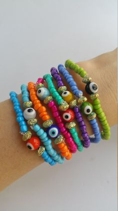 Beaded bracelet - stretch bracelet - Colourful Summer Bracelets - friendship bracelets - boho chic bohemian - evil eye jewelry - evil eyes Colorful seedbeed bracelets, you are buying 8 bracelets in this announce. Each bracelet is 7.5 inches TAKE ADVANTAGE OF COMBINED SHIPPING!!!! Only