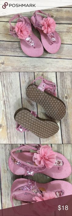 """OshKosh Pink Glitter Flower Sandals NEW Girls 7 OshKosh Pink Glitter Flower Sandals NEW Girls 7  Super cute Birkenstock style sandals from OshKosh.  Size is 7.  Flower accent.  New without tag.  Somewhat shopworn but not """"worn"""" worn.  Will look awesome on.  #new #nwot #gizeh #glitter #pink #looklikebirkenstock #oshkosh #sandals #summerkicks #coolkicks #summer Osh Kosh Shoes Sandals & Flip Flops"""
