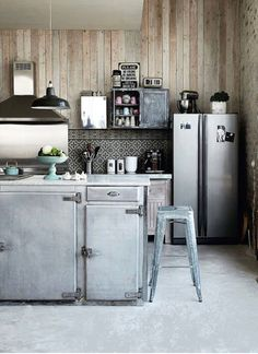 Industrial kitchen.  Swap that metal stool out for a lucite option and we've got a deal.