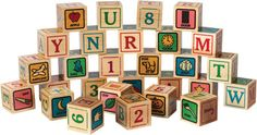 These Made in USA wooden ABC Blocks are a fresh interpretation of a classic toy. 28 solid blocks feature letters, numbers, simple pictures, and complete words colorfully printed on all 6 sides. 28 sol