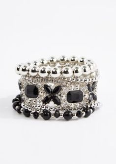 Get the vintage look with this goth-inspired set of silver tone stretch bracelets! Featured are black gems and crystals with art deco designs.