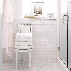 Marble penny tile floor with white faceted subway tile walls