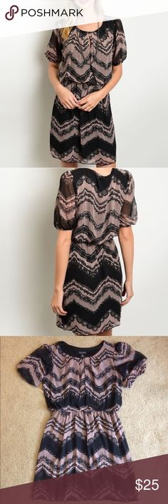 Blush and Black Lace Dress Mid length. Sheer sleeved dress. Fully lined and has a cinched waist. Teardrop button closure in the back. In excellent condition. Dresses Midi
