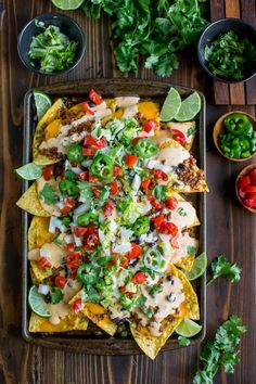 Easy Sheet Pan Nachos are topped with a speedy homemade queso and ready for faceplantage! They're totally customizable with vegetarian and T-Rex versions! Cheddar, Nacho Salat, Avocado Corn Salsa, Buffalo Chicken Tacos, Homemade Nachos, Vegetarian Nachos, Taco Fillings, Queso Cheese, Snacks
