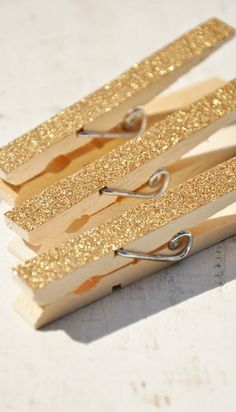 gold glitter clothespins for closing presents bags. Rust Oleum Glitter, Glitter Clothespins, Arts And Crafts, Diy Crafts, Tree Crafts, Going For Gold, Shimmer N Shine, Sparkle, Hanging Pictures