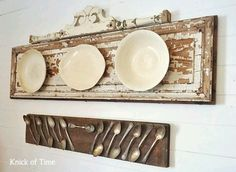A reclaimed door and finial make for a fabulous frame for your favorite china and try a piece of reclaimed wood to display your old siverware.