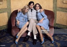 English singer Bryan Ferry with Roxy Music vocalists Doreen Chanter (left) and Jacqui Sullivan, at the Montcalm Hotel, London, 31st October 1975. The ladies are wearing Antony Price GI outfits.
