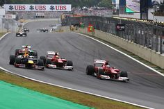 Fernando Alonso of Spain and Ferrari leads from Mark Webber of Australia and Red Bull Racing, Felipe Massa of Brazil and Ferrari and Nico Hulkenberg of Germany and Force India