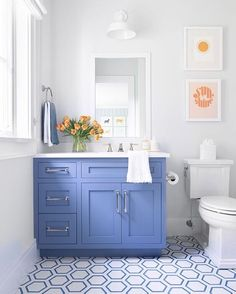 Positioned on white and blue hexagon tiles, a blue shaker washstand accented with a white quartz countertop and fitted under a white framed inset medicine cabinet lit by a white barn light. Bathroom Renos, Bathroom Kids, Girl Bathroom Decor, Bathroom Showers, Bathroom Renovations, Small Bathroom, Bathroom Interior Design, Bathroom Designs, Beautiful Bathrooms
