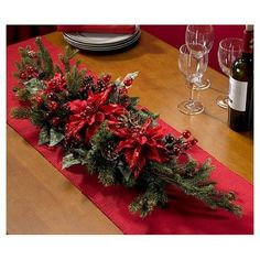 Exploding with color and festive charm, this Poinsettia silk plant brings instant holiday magic wherever you place it. The poinsettia blooms, leaves, pine needles, berries and pine cones complete this table decoration.Real Looking Poinsettia & Berry Christmas Flower Arrangements, Christmas Table Centerpieces, Christmas Table Settings, Christmas Tablescapes, Xmas Decorations, Holiday Tables, Centerpiece Decorations, Centrepieces, Christmas Wreaths