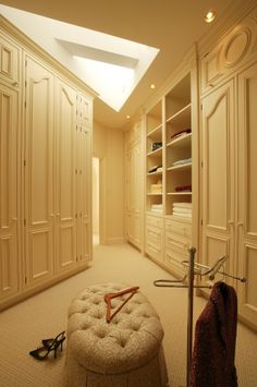 Traditional closet by Dalia Kitchen Design. @Sam Ramos, please note: skylight and carpeting. How do you feel about this?
