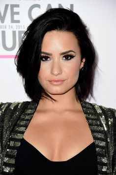 """""""Demi's bob has some face-framing layers and is textured all over,"""" says Max Gierl, senior stylist at Mizu New York. """"The rounded look comes from first blowing it out with a round brush, then breaking it up with pomade or spray wax."""" Better yet, he says you can easily nail this look by skipping shampoo for two or three days and then going for it.   - Redbook.com"""