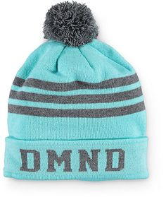 Accent your cold weather look with some shine in this cuffed style beanie that featured DMND lettering and stripe detailing, finished with a solid pom at the top.