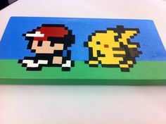 Ash and Pikachu Pokémon Nintendo 8 Bit Pixel Art von KaterineArts, $50.00