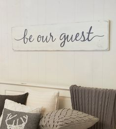 Hand painted wood sign, Be our guest. This is a perfect size for above a guest bed. Pictured above a queen size bed. *This sign is apprx. 47 wide x 11.25 high. Also available in size 28 wide x 7.25 high... www.etsy.com/listing/270658096/be-our-guest-rustic. *The lettering is hand painted. *The base is a distressed antique white. *The lettering is a charcoal gray. *It includes a sturdy wire hanger already installed on the back. *If youd like to purchase more than one sign from ...