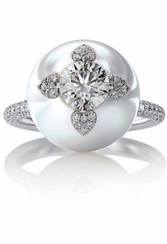 Mikimoto Pearl and Diamond ring, love how the diamonds are set into the pearl~ gorgeous