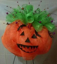 This pumpkin wreath's face is attached by magnets. When halloween is over it can still be used for fall.