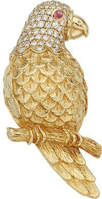 Diamond, Ruby, Gold Enhancer. The parrot enhancer features full-cut Diamonds weighing a total of approximately 1.25 carats, accented by a Ruby cabochon, set in 18k Gold. Gross weight 30.43 grams. Dimensions: 2-1/4 inches x 1 inch.