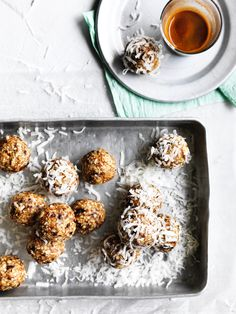 Some people might call these bliss or energy balls – we call them can't-stop-at-one delicious. These little bites of goodness, with a good whack of salt cutting through the sweetness, make the perfect lunchbox snack or after-dinner treat. We've rolled ours in extra coconut, but they could also be dusted in raw cacao to make them look like truffles.