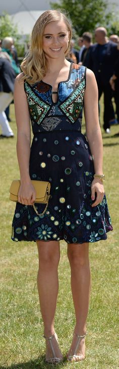 British model Suki Waterhouse wearing a Burberry dress from the A/W15 collection at the menswear show in London today