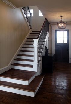 Hand scraped dark wood floors with white woodwork - definitely the way to go.