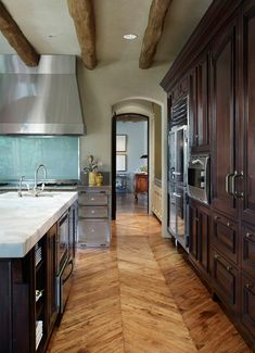 Floor! ....this French country kitchen from a home in Monte Sereno, California strikes the perfect balance between rustic and elegant. I love all the natural elements here, the open shelving and nooks, and the big island, not to mention the windows and fab aqua backsplash