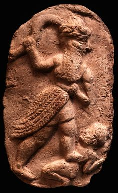 Old Babylonian Terracotta Plaque: God with Sword smiting Enemy. Mesopotamia; 1800-1600 BC