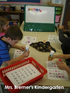 Mrs. Bremer's Kindergarten: Reach into a bag pull the letter out and mark it off with bingo dabber and other literacy stations