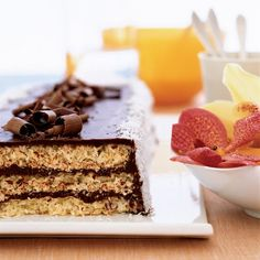 Triple-Layer Chocolate Macaroon Cake   François Payard layers chewy coconut cake with silky chocolate ganache. The beauty of the recipe is its simplicity: It has only six ingredients.