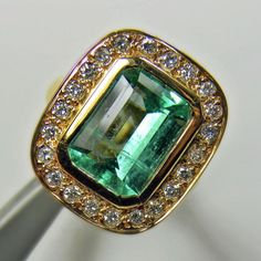 Composition: Solid Yellow Gold 18K Primary Stone: Natural Colombian Emerald Shape or Cut: Emerald Cut Approx Emerald Weight: OVER 4.00 Carats (1 emerald) Measurements Emerald: 11.00mmx8.00mm Average C   #emeraldring#HighJewellery#emerald#finejewelry#emeraldsmaravellous#emeralddiamondring#engagementring