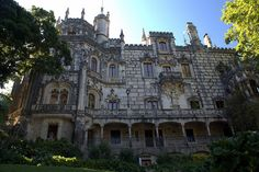 """Quinta da Regaleira is an estate located near the historic center of Sintra, Portugal. It is classified as a World Heritage Site by UNESCO within the """"Cultural Landscape of Sintra"""". Along with other palaces in this area , it is one of the principal tourist attractions of Sintra. It consists of a romantic palace and chapel, and a luxurious park featuring lakes, grottoes, wells, benches, fountains, and a vast array of exquisite constructions."""