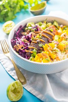 These Whole30 fish taco bowls with mango salsa, guacamole, chipotle aioli, and coconut-lime cauliflower rice, make an absolutely wonderful Whole30 dinner.
