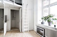 An tiny apartment in an ex old school in Stockholm, Sweden. Apartment entrance, bathroom, tiny kitchen unit and storage. There is all room for it under the bedroom loft. The other half of the apartment has 'almost' double normal ceiling height. Bright and lovely!