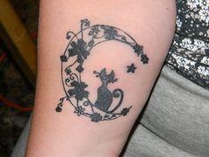 My moon kitty tattoo.