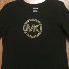 Michael Kors rhinestone tshirt sz small NWOT Michael Kors rhinestone longsleeve shirt. I took the tags off before trying it on and it was a little small for my liking. It has beautiful detail! Size small. No trades please. Michael Kors Tops Tees - Long Sleeve