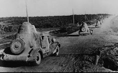 The column of armored vehicles BA-20M approaches the battle positions.